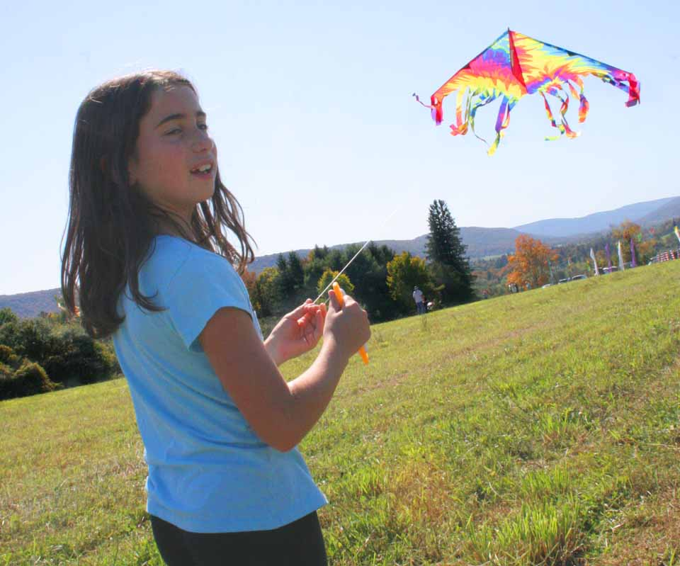 Jordan Forbes, Oneonta, flies an always-reliable Delta kite at today's Cherry Valley Kite Festival, which continues until 4.  (Ian Austin/allotsego.com)