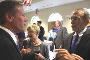 State Sen. David Valesky, D-Oneida, left, congratulates Bill Streck, guest of honor at this evening's Jedediah Peck dinner,   Between them is Streck's wife Karen.