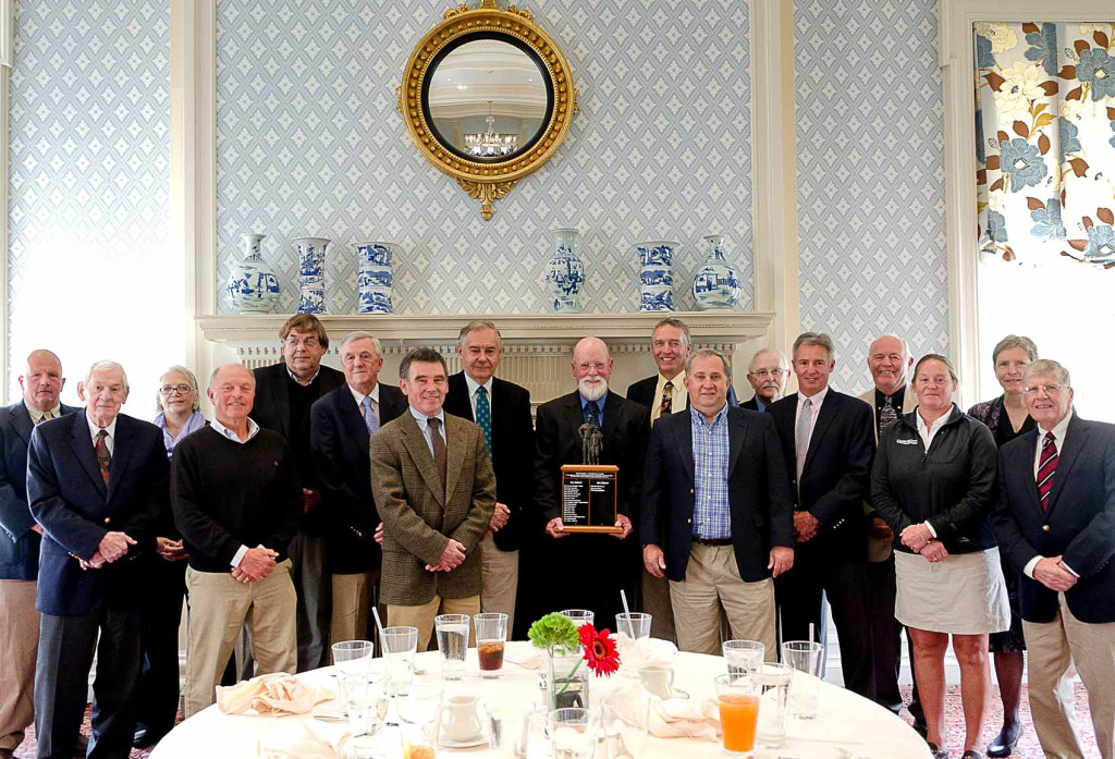 Winners of the Clark Sport Center's coveted Fetterman Award over the past 20 years gathered Wednesday to welcome Mark Rathbun, center, retired teacher, coach and former CCS board president, to the roster. Left to right are Bruce Andrews, Paul Lambert, Pat Hazzard, Frank Miosek, Ed Hazzard, Sharky Nagelschmidt, Jerry Townsend, Ted Spencer, Mark Rathbun, Dave Bliss, Dave Adsit, Jack Vineyard, Bob Snyder, Don Howard, Brenda Wedderspoon-Gray, Brenda Jaeger, and Ted Kantorowski.   Clark Sports Center board chairman Jane Forbes Clark presented Rathbun with the award. (Photo by Emily Kishbaugh, Clark Sports Center)