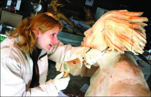 "Goaded by the fear inspired by immersion in Edgar Allan Poe's spooky stories, Stefanie Rocknak carves ""Gut Check,"" which goes on display next April at the Sculptor's Guild in Brooklyn. (Ian Austin/allotsego.com)"