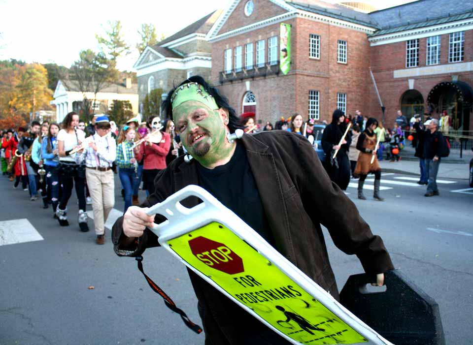 Frankenstein himself (or it is Alan Iverson, CCS marching band director) clears the way for, if not 76 trombones, an impressive array of musicians at the Cooperstown Halloween Parade stepped past the Hall of Fame shortly after 5 p.m. (Jim Kevlin/allotsego.com)