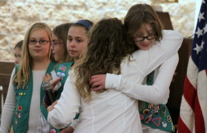 Members of Girl Scouts troop 30132 received their bronze awards on Wed. at the Elm Park Methodist church which recognized their leadership and community service in setting up a science fair that had 40 participants and 150 attendees. Here, group leader Rachel Rissberger embraces Anna Fleury after presenting her, along with Sasha Dudek, Julia Rissberger, Jessica Phillipe and Sabrina Scianimanico with their award pins.