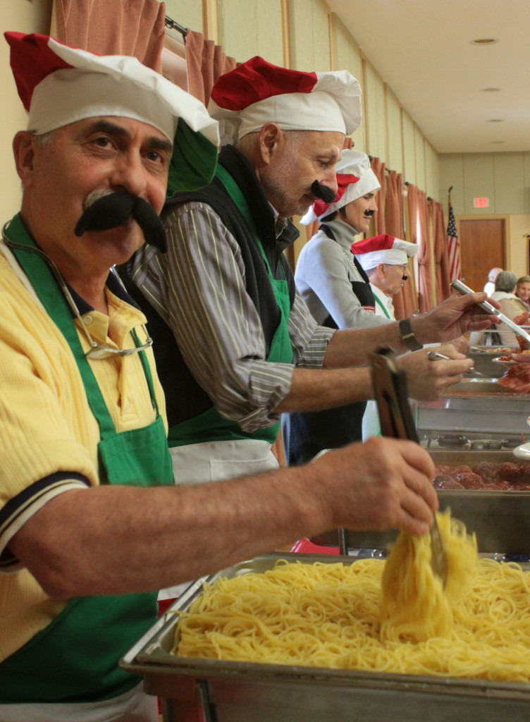 Rotary held an Italian themed luncheon on Thursday, where servers Charles Nicosia, Gary Herzig, Kelly McGraw and Joe Fodero all donned mustaches and chef hats to add to the festivities.