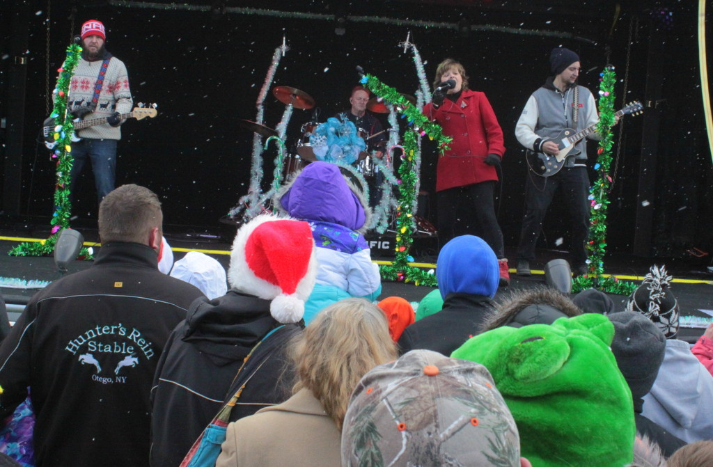 An unexpected snow began to fall on all those who turned out for the Canadian Pacific Holiday Train, which made its annual stop in Neawah Park on Friday to spread holiday cheer. After the side of the show car opened Anders Drerup, Ken Post, Tracey Brown and Adam Puddington sang several Christmas songs for the people of Oneonta before continuing east.