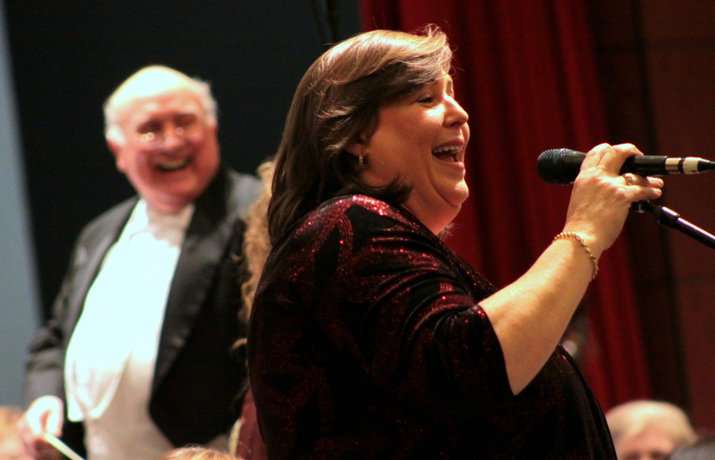 Joanie Madden, award winning whistle and flute player as well as leader of Cherish The Ladies since its beginning, keeps the audience laughing between sets with her wit and charm. Behind her is the music director of the Catskill Symphony Orchestra Charles Sneider, Frankfort. The event saw the groups' second visit to Oneonta and filled the Hunt Union Ballroom at SUNY.