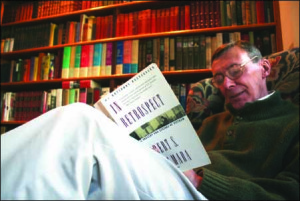 """Histories and memoirs of the Vietnam War, including Robert McNamara's apologia, """"In Retrospect"""" (1996), are among the volumes lining retired OHS principal Bud Pirone's Otsego Street study. (Jim Kevlin/allotsego.com)"""