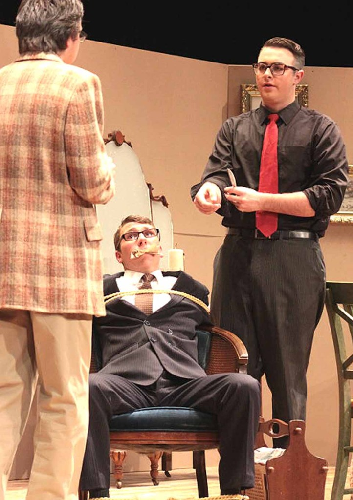 "It might be all over for the bound Mortimer Brewster (Joe Casassa) at the hands of his murderous brother Johnathan (Leo Frascatore), right, and Dr. Einstein (Gavin Smith), left, in the OHS Drama Club's production of ""Arsenic and Old Lace"" which opens tonight. Shows are at 7 p.m. Friday. and Saturday, and 2 p.m. Sunday at OHS. Tickets are $10 general admission, $5 students and seniors. (Ian Austin/allotsego.com)"