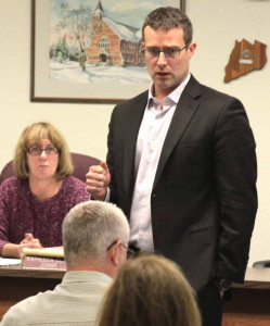 County Treasurer Dan Crowell, the county board's budget officer, outlines the 2015 spending plan at last Thursday's work session.  Behind him is Kathy Clark, R-Otego, county board chair.  (Ian Austin/allotsego.com)