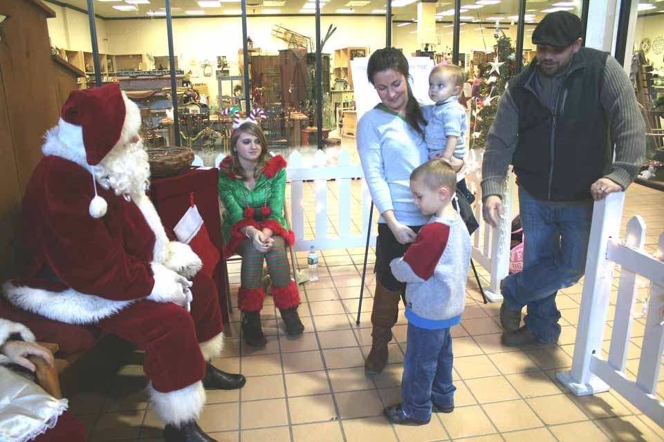 Jacob Hubner, 4, of Oneonta was a little bashful at first, but eventually he did sit on Santa's lap this afternoon at Schuylkill Mall and told St. Nick what's on his Christmas wish list.  Jacob was accompanied by his sister Piper, 1, and parents Melissa and John.  Santa will be a Southside Mall between now and Christmas on Saturdays, noon-4, and Sundays, 1-5.  Also Christmas Eve, 9 a.m.-noon.  (Jim Kevlin/allotsego.com)