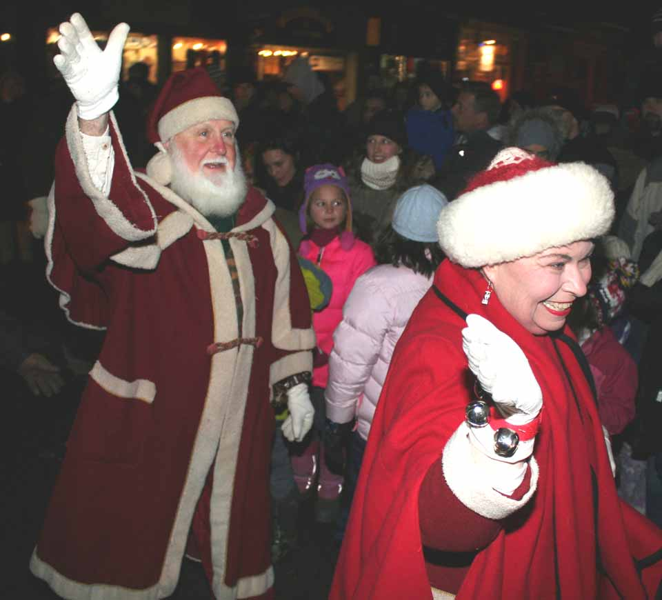 Santa Claus and Mrs. Claus arrive a few minutes ago at his cottage in Cooperstown's Pioneer Park, where he will be greeting youngsters and hearing their lists from now to Christmas.  (Jim Kevlin/allotsego.com)