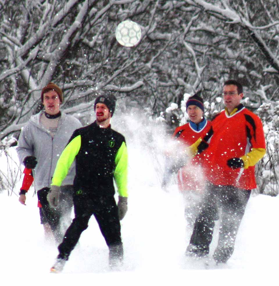 Six inches of snow didn't halt CCS' annual Turkey Bowl, with kickoff at 9:45 a.m. Thanksgiving Day.  Veteran soccer players again bested recent grads in the annual competition.  (Paul Donnelly/allotsego.com)