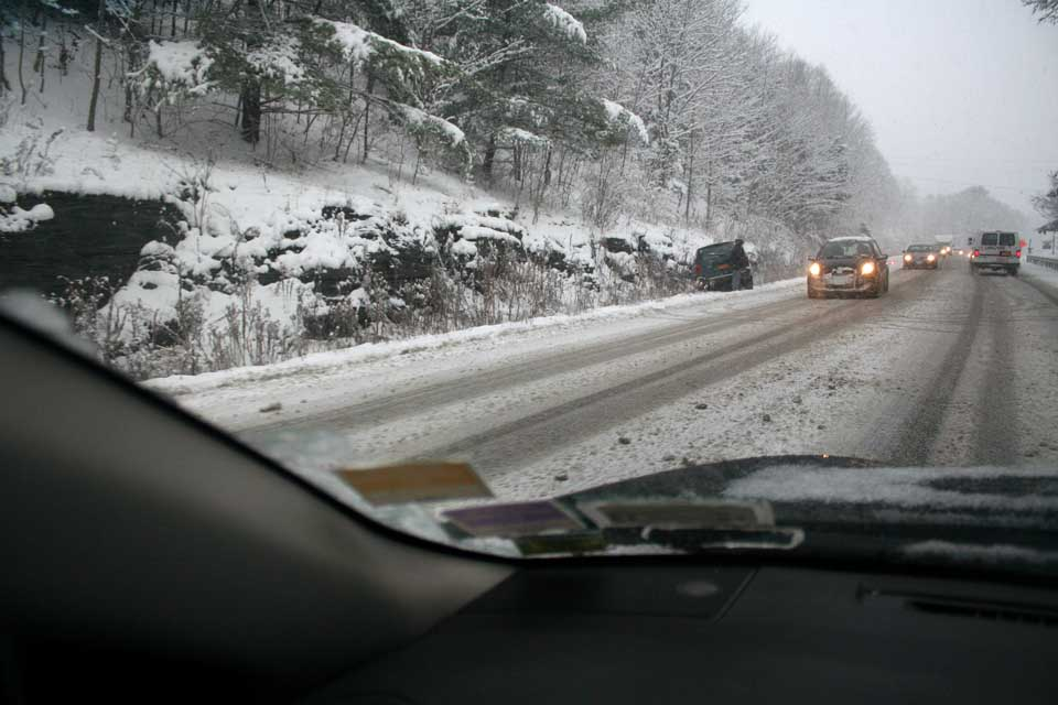 Cars began sliding off Route 28 shortly after three today, with three mishaps slowing traffic between I-88 and Cooperstown.   This one was just south of Taylor's at Goodyear Lake.  (Jim Kevlin/allotsego.com)