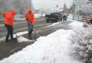 Sean O'Day and Megan Bliss of Bliss Landscaping, Oneonta, were shoveling sidewalks at the Otsego-Delaware Board of Realtors,  353 Main St., at 2:30 this afternoon at snow continued to fall steadily.