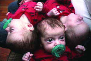 Triplets Hunter, Lucas and Noah O'Brien rest up after their afternoon snack.  The trio, born Sept. 30, are the only set of identical triplets in Otsego County.  (Ian Austin/HOMETOWN ONEONTA/The Freeman's Journal