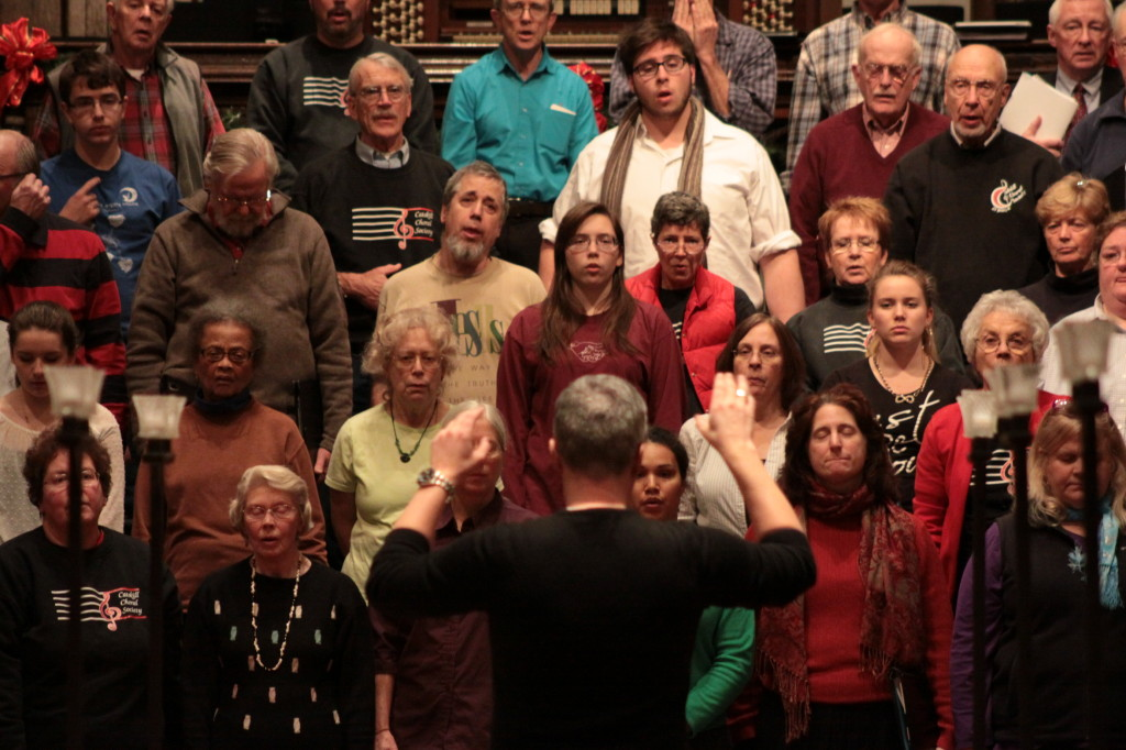 The Catskill Choral Society, under the directin of Dr. Colin Armstrong, front, begins their rehearsal in the First United Methodist Church on Tuesday evening in preparation for their upcoming Carols and Lullabies concert on Dec. 5th. (Ian Austin/ allotsego.com)