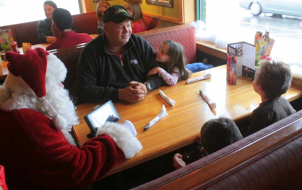 Children and their families got to share a pancake breakfast with Santa on Saturday morning. The Jolly old elf made sure to visit every table as they were waiting for their breakfast and double check the children's wish lists for this Christmas. Here, Chris Hannah, Charlotteville, listens as his children Elizabeth, Samson and Jacob tell Sata what they want.