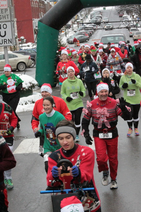 Runners in the first annual Ugly Sweater run take off from Pioneer Park on Friday afternoon.