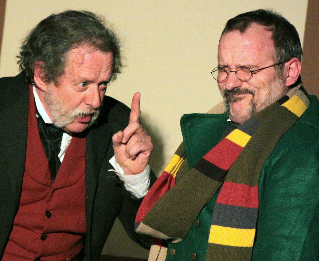 "Scrooge (Gary Koutnik) chastises Bob Cratchit (Steve Dillon) Saturday afternoon, as the Glimmer Globe Theatre and Templeton Players performed Charles Dickens' classic ""Christmas Carol"" for the second year in a row at The Farmers' Museum in Cooperstown.  (Ian Austin/allotsego.com)"