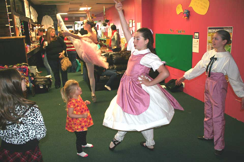 """Christmas was everywhere this morning in Oneonta.  Here, Clara (Sadie Tucker) wows youngsters at the OWL's Nest with a preview to Decker Dance Company's """"The Nutcracker,"""" to be performed next weekend at SUNY Oneonta's Goodrich Theater.  The Sugar Plum Fair (Rose Wake, behind), and Clara's brother Fritz (Grace Craig).  The dancers were Oneontans.  (Jim Kevlin/allotsego.com)"""