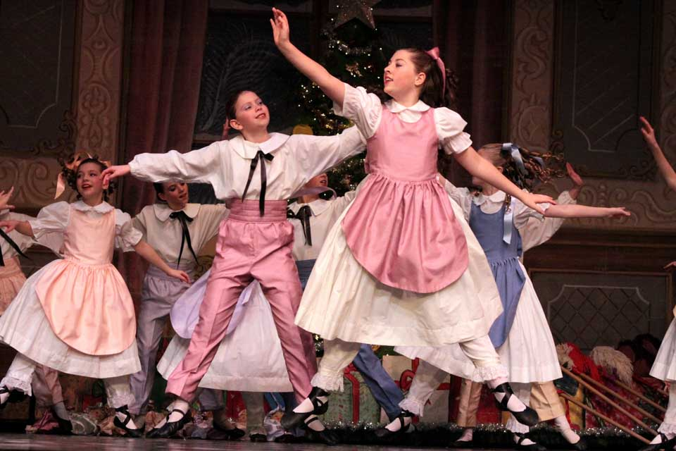 "Clara (Sadie Tucker of Oneonta) with support of brother Fritz (Grace Craig, behind Sadie) dances the lead in Tchaikovsky's classic ""Nutcracker.""  Performances were staged Thursday through Saturday at SUNY Oneonta's Goodrich Theater.  (Ian Austin/allotsego.com)"