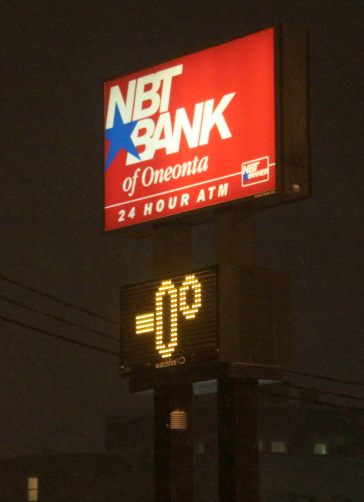 """While you would be hard-pressed to find a mathematician (or weatherman!) who would say that the temperature could be """"negative zero"""" as it reads on the NBT Bank thermometer in Oneonta, everyone can agree that baby, it's cold outside!  More accurately, the temperature hovers around -2, with a windchill as low as -30 expected tonight. (Ian Austin/allotsego.com)"""