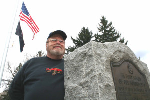 Gene Schmidt last fall at the cluster of monuments at the end of Veterans Memorial Walkway in Neahwa Park.  (allotsego.com photo)