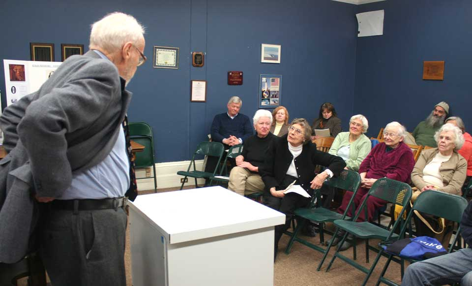 """Cooperstown Village Historian Hugh MacDougall fields a question from the Friends of the Library's Hilda Wilcox this afternoon after delivering a paper on """"Elinor Wyllys,"""" a little known novel by Susan Fenimore Cooper, daughter of James Fenimore Cooper.  The courtroom scene in """"Elinor,"""" and her father's  1850 mystery novel, """"The Ways of the Hour,"""" were early example of what continues as a popular genre today.  (Jim Kevlin/allotsego.com)"""