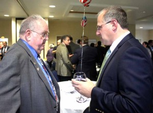 Assemblyman Magee confers with Cooperstown Mayor Katz at county Democratis' Jedediah Peck Annual Dinner at the Country Inn & Suites last September.  (allotsego.com photo)