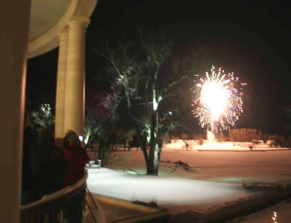 Revellers cheers from the veranda of The Otesaga a few minutes ago as the grand finale begins of the fireworks display that hails the beginning of the Cooperstown Winter Carnival.  (allotsego.com photo)