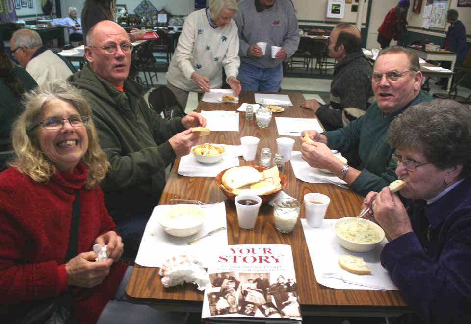 John and Jean Finch, left, and Pete Collins and Angie Harrington, right, partake of Soup 'R Chili during the noon hour at Cooperstown Baptist Church.  It's the annual unofficial launch of the Cooperstown Winter Carnival.  (Jim Kevlin/allotsego.com)