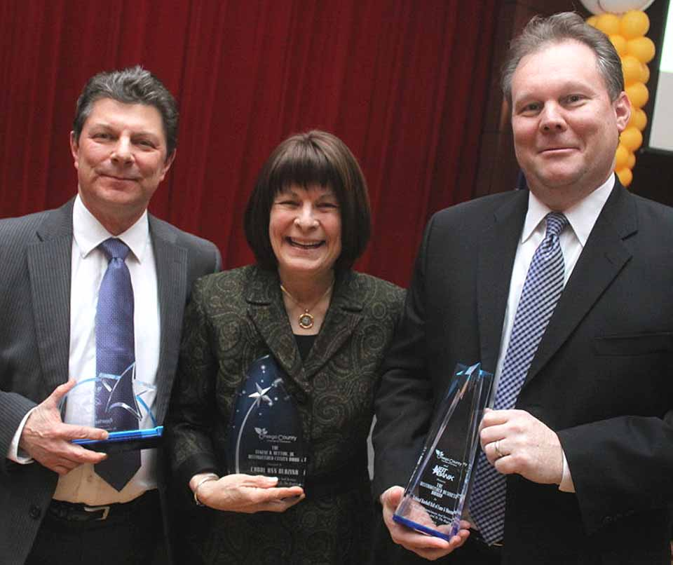 The three honorees of the 2015 Otsego County Annual Dinner & Celebration of Business pose after festivities ended last evening at SUNY Oneonta's Hunt Unio Ballroom.  From left are Dan Maskin, Opportunity for Otsego CEO; Carol Ann Blazina, retired SUNY Oneonta vice president and former president of the Foothills Board, and Sean Gahagan, Baseball Hall of Fame vice president.   OFO was the first recipient of the Quality of Life Award; Blazina is the Eugene A. Bettiol Jr. Distinguished Citizen; and the Hall is NBT's Distinguished Business.  (Ian Austin/allotsego.com)