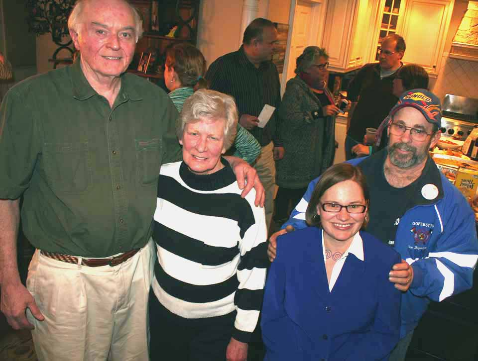 Cindy Falk and her husband, Glenn, right, and Jim Dean and his wife, Eileen, attend a celebration in their honor at Rich and Rosemarie Abbate's this evening after winning new terms on the Cooperstown Village Board.  (Jim Kevlin/allotsego.com) Cindy Falk and her husband, Glenn, right, and Jim Dean and his wife, Eileen, attend a celebration in their honor at Rich and Rosemarie Abbate's this evening after winning new terms on the Cooperstown Village Board. (Jim Kevlin/allotsego.com)