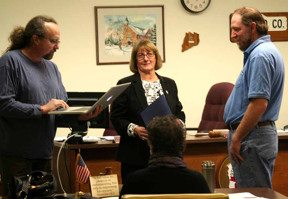 George Darling, right, who works in the maintenance department at the County Office Building, was recognized this morning with the quarterly Outstanding Employee Award at the monthly county board meeting.  Reading the citation is county Rep. Ed Lentz, D-New Lisbon.  The presentation was made by board chair Kathy Clark, R-Otego.  Darling was cited for performance, dedication and attitude.  (Jim Kevlin/allotsego.com)