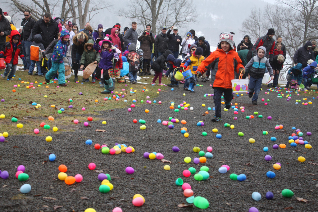 Flurries and chilly winds didn't stop the annual Hyde Hall Easter Egg Hunt on Saturday morning. Here, Parker Sitterly, Middlefield, in orange, dashes into the field of Easter eggs to find one of three chicks, which earned him a special Easter basket from John Manney. (Ian Austin/allotsego.com)
