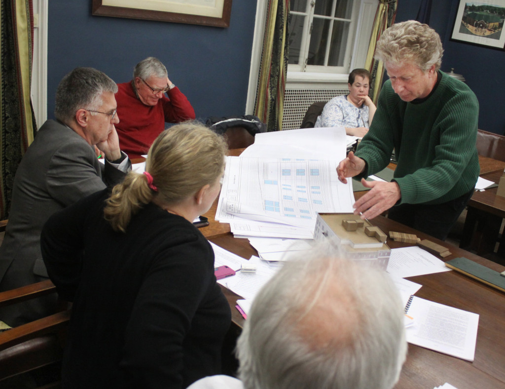 The Historic Architectural Review Board declined to approve the application for the proposed hotel at 124 Main st. in Cooperstown sighting shortcomings in the application, plans and materials.  Here, architect Kurt Ofer shows Liz Callihan, Ralph Snell and Roger McMillan the blueprints for the hotel.  Next week, he and his wife, HPARB chair Teresa Drerup, will present the plans to the planning board in hopes that the trustees will make a recommendation for the plans to continue.