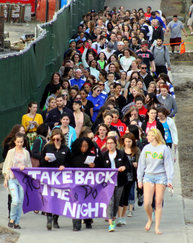 Students from Hartwick and SUNY walk in the 13th annual Take Back The Night march, which went from Milne's Library to Hartwick campus where Heather Sims spoke about her own experiences with assault. The walkers then continued on down to Muller Plaza where there were singers, speakers and information. (Ian Austin/ allotsego.com)