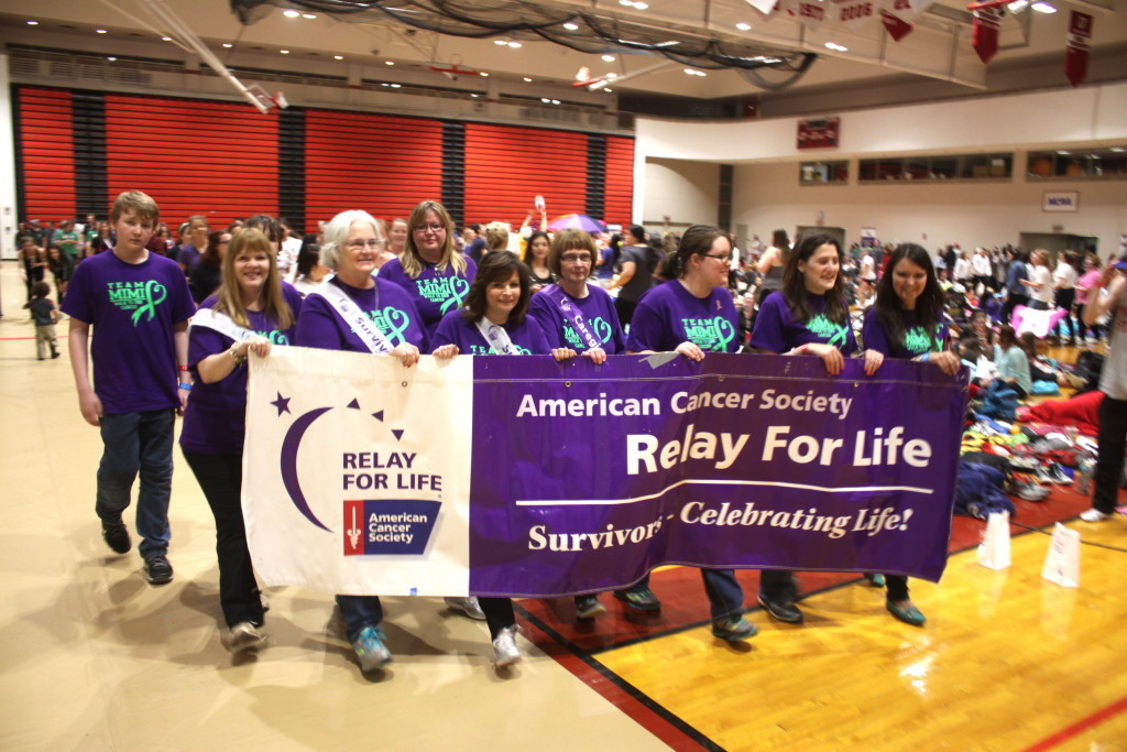 The SUNY Alumni Field House hosted the annual Relay For Life last night, which, at 11pm, had made over $51,000 dollars. Seen here are members of Team Mimi, which was formed three weeks ago to honor the late Jackie Ruff who had worked at SUNY. Under the leadership of Laurie Emmett they have started a peer lead support group for people living with Cancer and their families on the 3rd Wed. of every month at the Hunt Union. From left: Ethan Lowe, Otego, Elaine Lowe, Otego, Moira Beach, Oneonta, Diane Loveland, Otego, Laura Emmett, Maryland, Judi McWherter, Oneonta, Rachael Price, Oneonta, Kate Bronk, Oneonta, and Natalia Allen, Oneonta. (Ian Austin/ allotsego.com)