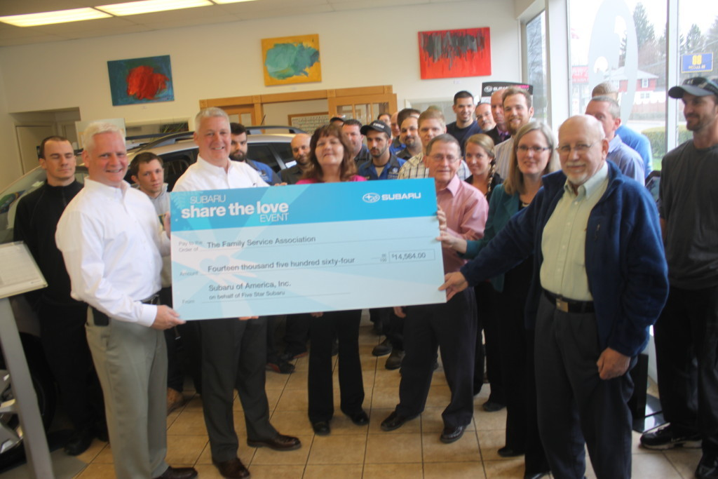 Blaine Jennings and Ben Guenther of Five Star Subaru present a check fo $14, 564 to Kim DeFalco, Rudy Ballard, Vicki Salmon and Fred Albrecht of Family services. The donation comes from Five Star Subaru's Share the Love Event back in Dec. where anyone buying a car could donate part of the purchase cost to the cause. This is the first year that they have been able to donate to a local charity. (Ian Austin/ allotsego.com)