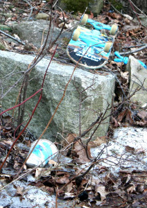 An overturned skateboard in the driveway underscores what a neighbor reported:  That a family with children lived there.