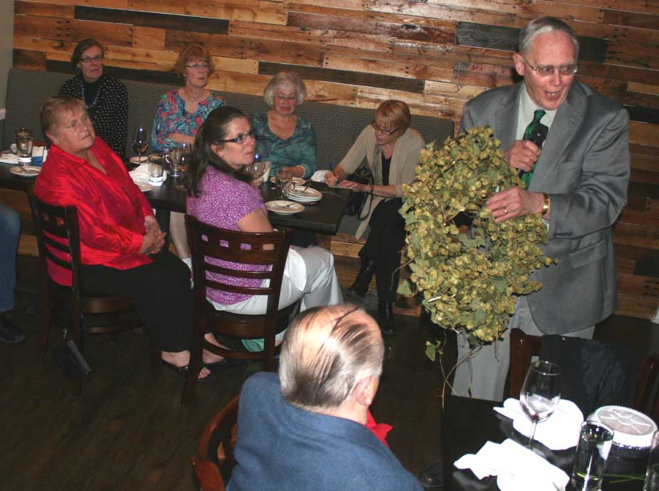 Hops history expert Al Bullard of Milford holds up a garland of hops flowers as his began his address at the Greater Oneonta Historical Society's annual dinner last evening at Toscana's on Chestnut Street. In 1880, the Central NY hops region produced 20 million pounds of hops, and we're a long way from that, Bullard said, but 20 years ago there were no commercial hops being grown in Otsego County at all. The Farm Brewery Act of 2012, which requires 90 percent of ingredients be grown in state by 2022, has changed that, he said. Sixty people – a full house – attended the dinner, a fundraiser for the GOHS. (allotsego.com)