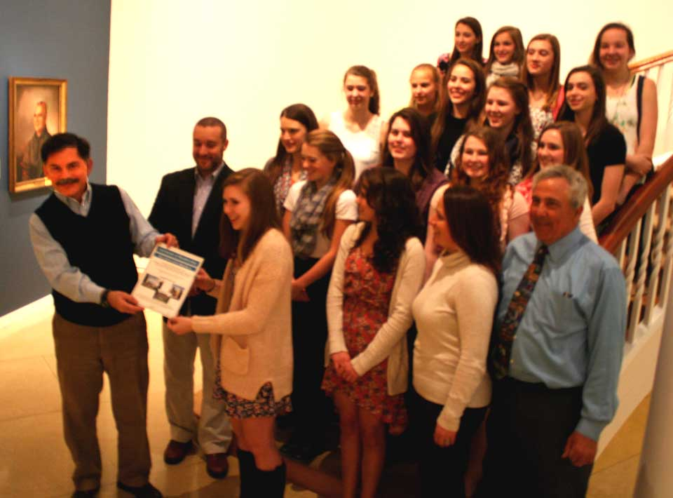 NYSHA President Paul D'Ambrosio presents family members to Lady Hawkeye Basketball Team captain Liz Millea, then to the rest of the state championship team a few minutes ago in appreciation of their unprecedented accomplishment:  They were the first CCS basket ball team to win a state title.  The memberships admit the families into the museums, and to membership events, including the spring reception Friday evening.  (Jim Kevlin/allotsego.com)