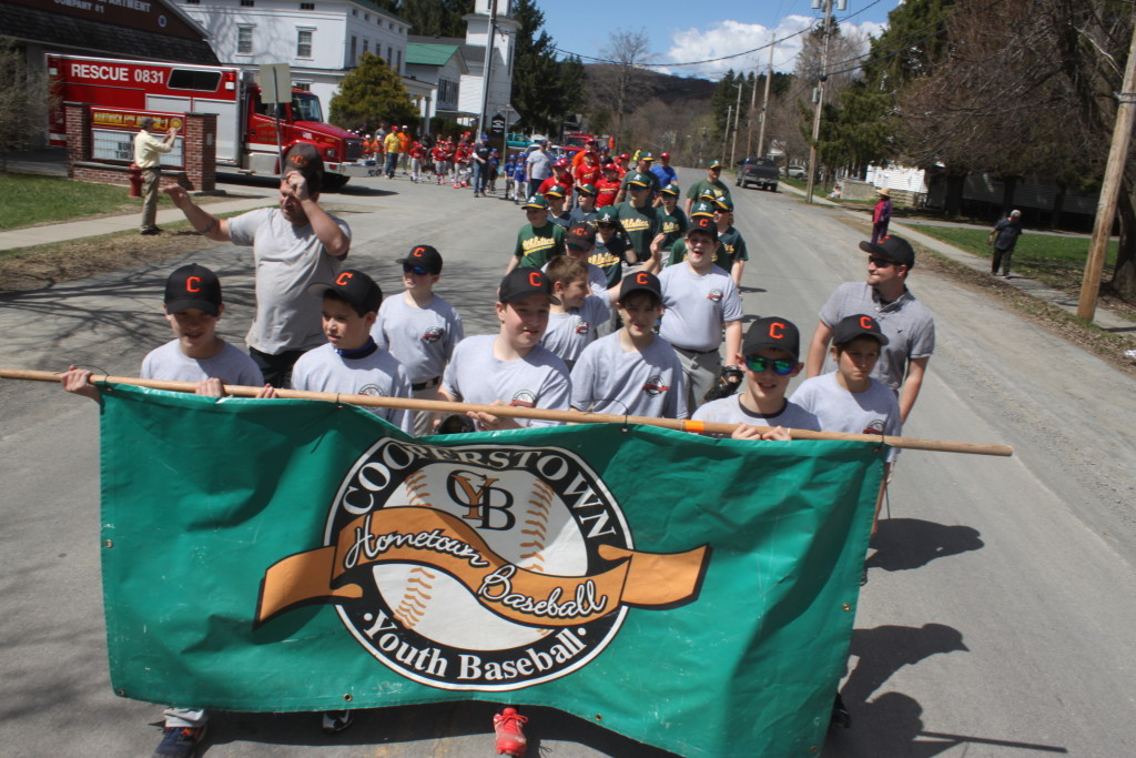 Alex Hascup, Toddsville, Jason Furnari, Hartwick, Sam Rhodes, Cooperstown and Derek Moore, Hartwick, lead the Little League Parade in HArtwick on Saturday morning to ring in the new season, and for many, that start of summer. (Ian Austin/ allotsego.com)