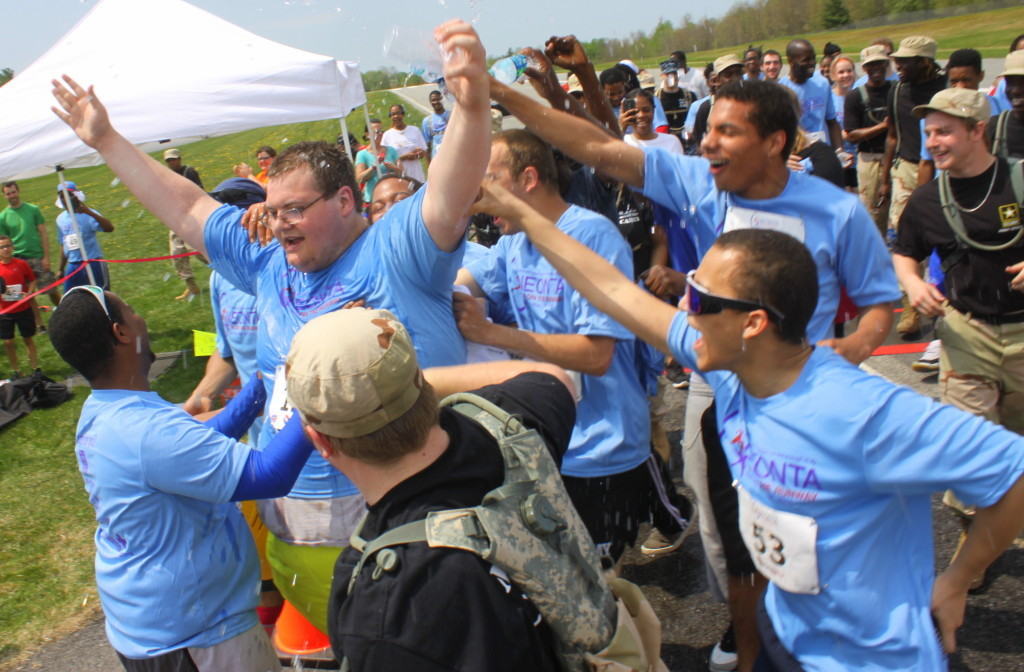After an hour and twenty four minutes or determination, Matthew Levinson, a student at Oneonta Job Corps Academy, crossed the finish line of his first race, the Mother's Day 5K on the Runway, surrounded by fellow students and runners cheering him on for support. Runners who had already finished ran back out to walk with him and support him all the way to the end. (Ian Austin/allotsego.com)
