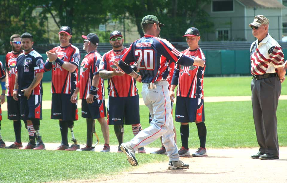 The Wounded Warriors' lineup is introduced at Doubleday Field.