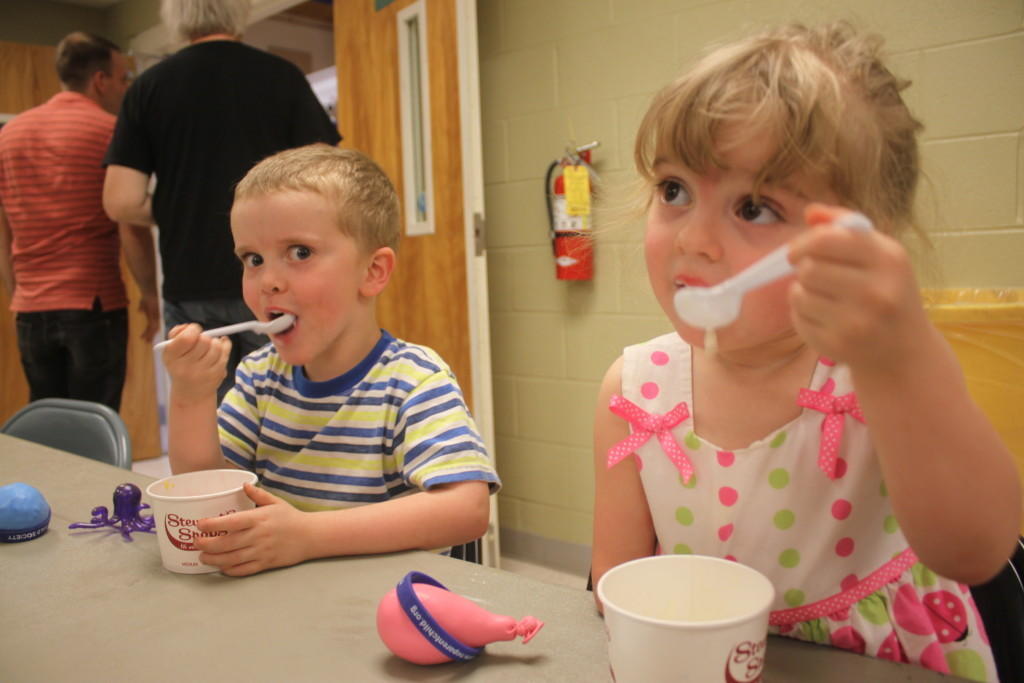 Owl's annual Ice Cream Social was held Sunday afternoon at the Oneonta Boys and Girls Club where children and their families could enjoy cool treats, dancing, crafts and learn about archaeology. Here, Josie Baldanza and her brother Liam, eat their ice cream which was served by OHS volunteers. (Ian Austin/allotsego.com)