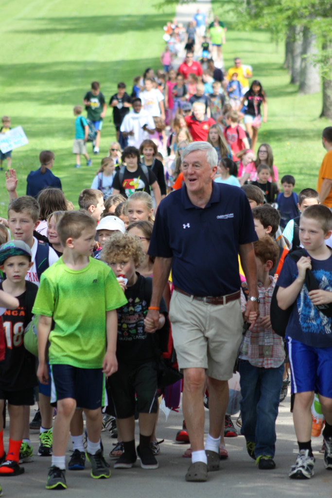Nearly 100 students, friends and co-workers gave Sharkey Nagelschmidt, center, Cooperstown, an honorable send off by walking with him from CCS to the Clark Sports Center, where he will be holding his last day of children's after school activities before his retirement. (Ian Austin/ allotsego.com)