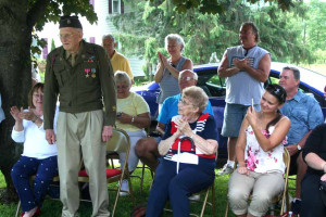 His Laurens neighbors (and wife Betty, to his left) applaud Mr. Brindle after he recieved the Bronze Star.