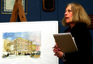 Architect Teresa Drerup discusses an artist's rendering of the proposed hotel at an earlier meeting.  (allotsego.com photo)
