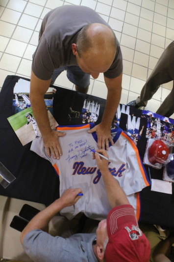 "3-time all star Lenny ""Nails"" Dykstra was at the Southside Mall on Saturday signing autographs for fame like Russ Taylor, Oneonta, who brought in a 1987 New York Mets  Dykstra jersey  given to him by his brother. (Ian Austin/ allotsego.com)"