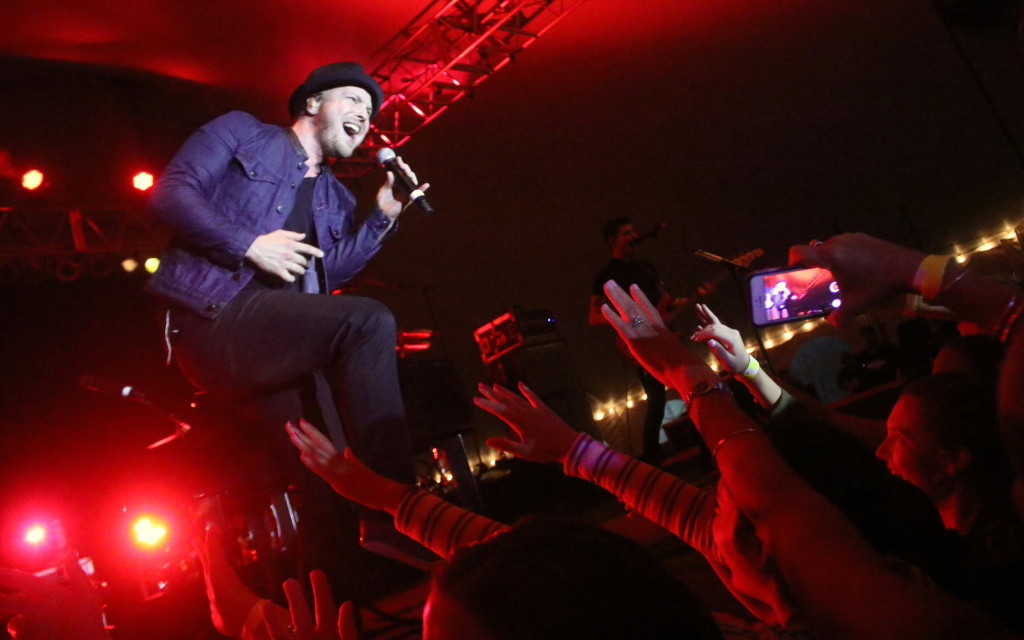 Despite ankle deep mud - even under the tent - Rock and Roll revelers came out in droves to hear Gavin DeGraw play at the Hospice Celebrity Party this evening at the 6th Ward Booster Club. (Ian Austin/allotsego.com)